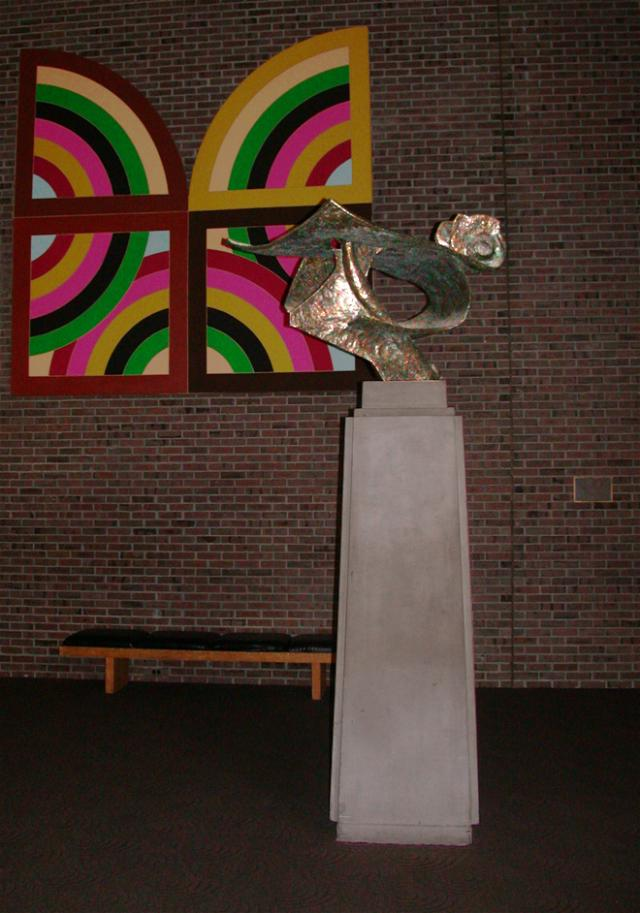 Voyager statue in front of artwork