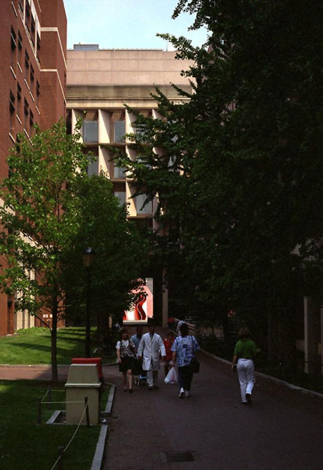 Edward J. Stemmler Hall with people walking out of the building