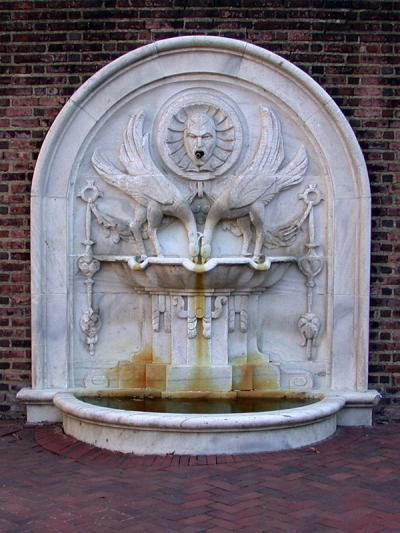 University Museum Fountain in front of a brick wall
