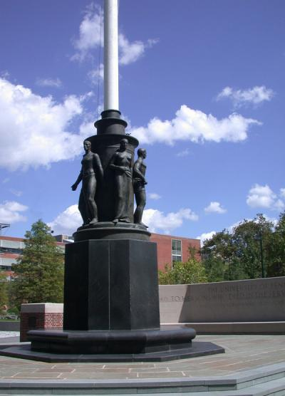 War Memorial Flagpole with figures at the base